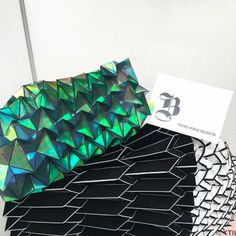 Inspired by architecture combines iridescent materials with origami structures Paper Structure, Home Trends, Iridescent, Cube, Origami, Designers, Inspired, Architecture, Inspiration