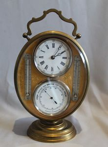 stock number 4989  Antique French gilt bronze oval combination desk timepiece with aneroid barometer and thermometers