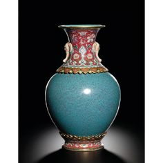 AN EXTREMELY RARE AND MAGNIFICENT ROBIN'S EGG AND FAMILLE-ROSE REVOLVING VASE SEAL MARK AND PERIOD OF QIANLONG Estimate 3,862,500 - 5,150,000 USD LOT SOLD 9,025,375 USD. 08/04/11 ||| sotheby's hk0358lot5zkccen