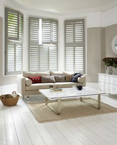 Simple and timeless window dressing for this large bay window. Tier on tier shutters allow light to flood through and provide privacy from onlookers. Bay Window Bedroom, Bay Window Living Room, Bay Window Curtains, Living Room Decor, Window Shutters Uk, White Shutters, Bay Window Dressing, Bay Window Treatments, Interior Windows