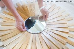 Hey there! Kev here. Like Lay mentioned in yesterday's post, I'm here to show you how I made the sunburst mirror for my Mom and Dad's porch. Thanks to Kate's tutorial, it was really easy to put together. First, I went to Hobby Lobby to pick up three different-sized wood floral rings. Unfortunately Hobby Lobby …
