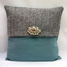Eco-friendly British tweed wool and green organic cotton cushion with ceramic feature button