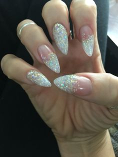 Sparkle stiletto nails.