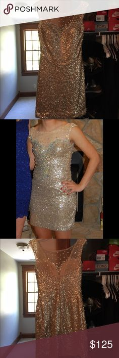 Hannah S Formal/Homecoming Dress,  Gold Size 2 Very sparkly gold homecoming dress. Stretchy, and very easy to move around in. Dresses Prom