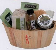 Attractively packaged in wooden bucket with green tea packet, 2 Oz. green tea scented votive, water lily bath crystals, wooden nail brush, 1 green leaf bath fizzy, 1.25 Oz green tea soap and 2 Oz. mandarin ginger bath gel. #timelesstreasure