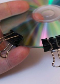 She clips two binder clips to an old CD. When she turns it over? Genius
