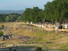Spectators at the Pont du Gard: If you're in Provence in June, be sure to check out the spectacle at the Pont du Gard: Les Féeries du Pont where there are fireworks, a  sound and light show and live theatre. http://www.francetraveltips.com/spectacle-pont-du-gard-feeries-du-pont/