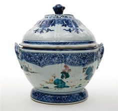 Chinese Export Porcelain Covered Tureen  Qianlong Period, late 18th century  The circular tureen painted with famille rose enamels with pagodas in landscape, all within an elaborate underglaze blue scrolling leafage border, with high pierced domed cover.