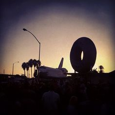 Photo by KPCC. This is the space shuttle being towed past Randy's Donuts in California.