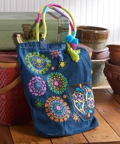 DIY Bohemian Festival Bag. Hand Stitch these vibrant patterns onto a denim bag using Bucilla stencils for a fabulous summer tote.