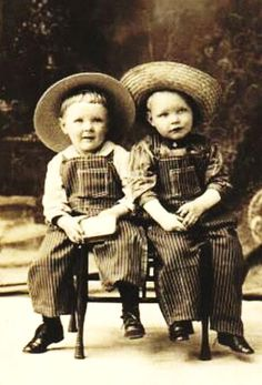 little boys. The one on the right looks like a photo I have of my dad.bj
