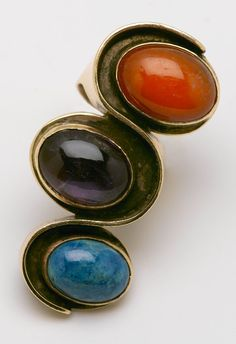 "Art Smith. ""Undulation"" ring. Gold, chrysocola, amethyst, carnelian.ca. 1961. One of the leading modernist jewelers of the mid-twentieth century, Smith trained at Cooper Union. Inspired by surrealism, biomorphicism, and primitivism, Art Smith's jewelry is dynamic in its size and form. Although sometimes massive in scale, his jewelry remains lightweight and wearable. See ""From the Village to Vogue: The Modernist Jewelry of Art Smith""."