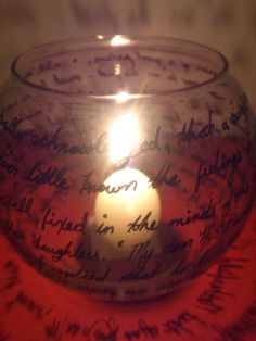 Glass candleholder with writing from Jane Austen or Charlotte Bronte on the outside. Perfect for a literary / book themed wedding! Light a candle inside, and see the writing cast on your walls! Pride and Prejudice is featured in this picture. Discount on large orders. #JaneAusten #PrideAndPrejudice #Elizabethanddarcy Wedding favor. Party favor.