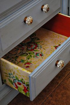 Line inside of dresser drawers with decoupaged fabric, wallpaper, etc,