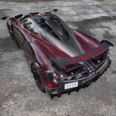 """Pagani Huayra BC """"Kingtasma"""" in Red and Black carbon fiber w/ Red accents, Tricolore stripes & 24 Karat gold crowns under the rear aerodynamic flaps.   Photo taken by: @keystothejungle on Instagram   Owned by: @sparky18888 & @vtm_theking_4 on Instagram"""