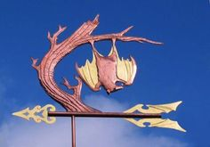 Hanging Bat Weather Vane by West Coast Weather Vanes.  The Bat weathervane featured here has brown glass eyes with black pupils and optional gold leaf on the bat's inner wing panels and the arrow tip and fletching.  We recently finished a version of this design for a couple in France who reside in an area with numerous bat colonies.