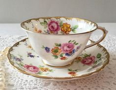 Beautiful vintage china tea cup, made by Royal Chelsea in England. This is a lovely duo with gold details and lovely flowers over both the cup and saucer. It is in good condition, no chips, cracks or crazing. Please Note: The items I sell are not new, they are vintage or