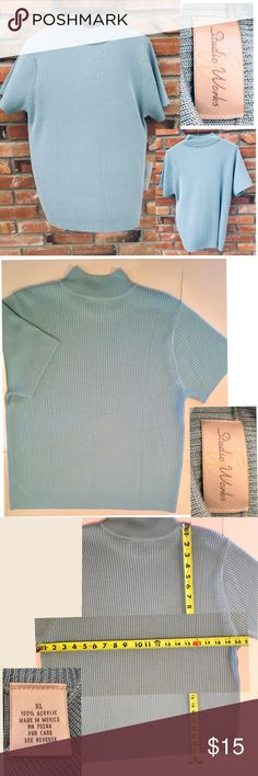Short sleeve blue ribbed knit top This pullover with mock turtle neck is made from 100% Acrylic ribbed knit that has a comfortable fit. Colors may vary due to lighting. Measurements are taken flat. See photos for measurements. Thank you for looking. Studio Works Tops