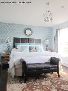 Stunning blue bedroom has an accent wall using the Marrakech Trellis wall stencil from Cutting Edge Stencils.