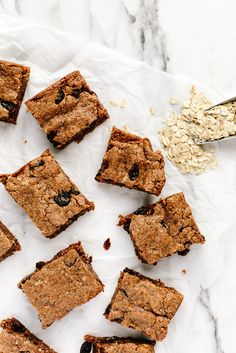 Vegan + Gluten-Free Oatmeal Raisin Cookie Bars | These gooey, dense, and chewy bars are sweetened with coconut sugar and packed with oats!