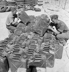 Salvaged German petrol cans or 'jerricans' being inspected at a depot in the Western Desert, 21 April The robust German cans were considered far superior to the British 'flimsy' can and highly prized. Ww2 History, Military History, Operation Torch, Afrika Corps, North African Campaign, Jerry Can, Ww2 Tanks, Military Diorama, British Army