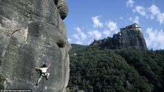 Head for heights: French mountain climber Catherine Destivelle during her ascension of the Rocher Saint Esprit, in the Meteora, with the Monastery of Roussanou located on a parallel summit (right)