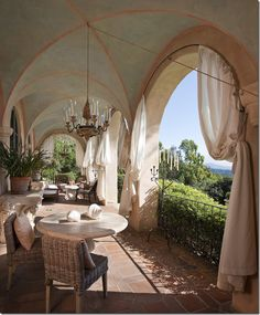The arched balcony off the living room of a coastal California mansion.