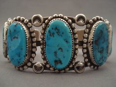 """Large silver beads each measure around 1/4"""" X 1/4"""". The stones measure around 1"""" x 1/2"""". The width of the bracelet measures around 1-1/4"""". Signed by Navajo artist, Ron Long. Sterling silver. 1980's . 