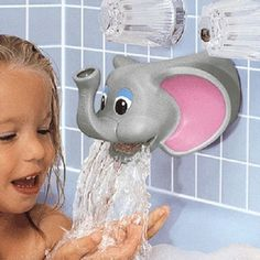 Man, that elephant really partied hard last night. That's all I want my adult bathroom to be decorated with: water vomiting wildlife.