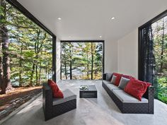 Hill-Maheux Cottage. The screened porch is overlooking the lake. It is a cross point between in and out, redefining the home's boundaries, creating visual and functional link with nature.
