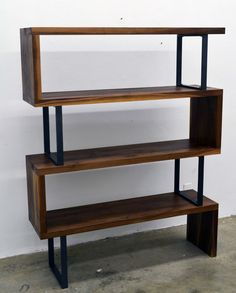 Bookshelf stands tall long inches deep and between shelves. Made with Solid walnut shelves and powder coated steel supports.The walnut shelves measure about thick so they can… Pipe Bookshelf, Modern Bookshelf, Wood Bookshelves, Bookshelf Design, Bookshelf Decorating, Bookshelf Door, Creative Bookshelves, Bookshelf Ideas, Decorating Ideas