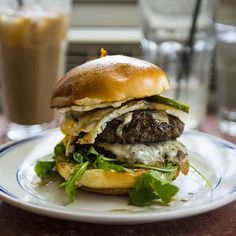 Proper Burger at Duke's Grocery in Washington, D.C. : TWO patties with smoked Gouda, sweet chili sauce, charred red onions, dill pickles, arugula, garlic aioli, and a fried egg on top