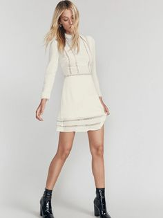 Romance yourself. This is a long sleeve, fit and flare dress with lace trim detail and a high neck. Shower Outfits, Shower Dresses, Rehearsal Dinner Dresses, Rehearsal Dinners, Winter Bridal Showers, Little White Dresses, Bridal Outfits, Flare Dress, Fit And Flare