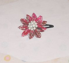 http://www.instructables.com/id/How-to-make-a-kanzashi-folded-fabric-flower-pin/