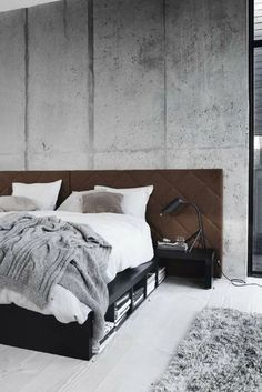 There's no space in the home that calls for the cool and soothing vibes of concrete walls quite like the bedroom. Consider a similar look for your own boudoir to maximise your potential for a deep, stress-free slumber. https://nyde.co.uk/blog/springs-concrete-trend/