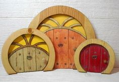 Look at these cute wooden doors for gnomes!!  Would be awesome on a mantel with gnomes, toadstools, mini trees, and such