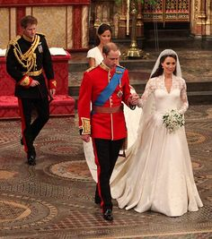 After signing the Royal Registry and the official marriage license Prince William, Duke of Cambridge and Catherine, Duchess of Cambridge followed by Prince Harry and Pippa Middleton enter the abbey to greet HM Queen Elizabeth II.