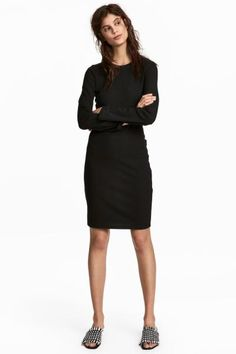 Fitted jersey dress with long, straight sleeves. Unlined.