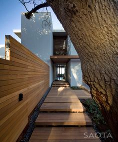 decking walkway.  love the fence too. via desire to inspire