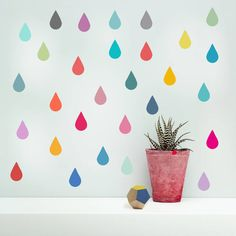 Add some excitement and fun to your room with these fabulously colourful raindrops which work particularly well in children's rooms and playrooms. Each set contains 48 raindrops. These stickers come in 6 different set colours. Why not combine two different packs to create your own unique look.These stickers add a splash of colour to any room and work great on white walls with their stand out colour.  These vinyl wall stickers have a matt finish, so they look like they have been painted onto…