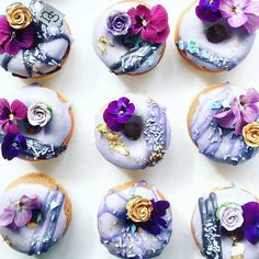 Violet shades on icing with real flower accents on these donuts