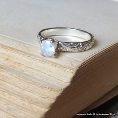 The popular moonstone ring in the bright finish. Beautiful blue flash rainbow moonstone gemstone ring. A lovely promise ring, unique engagement