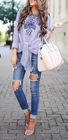 Distressed denim + embroidered blouse.