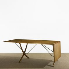 The Achilles table has a raw oak top with soft chamfered edges ...
