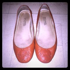 Orange MIchael Kors Flats These are leather MICHAEL by Michael Kors flats. They feature a MK symbol in orange leather. They have been used but have a lot of life in them. MICHAEL Michael Kors Shoes Flats & Loafers