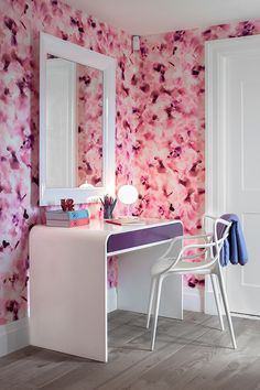 Stunning home office with pink cherry blossom wallpaper framing a white lacquered mirror over a white waterfall edge desk with purple drawer front lined with a Kartell Masters Chair over gray wash hardwood floors. Modern White Desk, Contemporary Desk, Home Office, Office Nook, Philippe Starck, Decor Pad, Room Decor, Childrens Bedroom Wallpaper, Chaise Masters