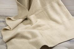 """Heavy Wool Blanket / 44"""" x 59"""" / 110 x 150 cm / 100% Sheep Wool. 100% SHEEP WOOL HEAVY BLANKET, DIMENSIONS: 44"""" x 59"""" (excluding the fringe), WEIGHT: 2.40 lb. Sheep Wool is a natural fiber and it is:Environmentally Sustainable; Hypoallergenic - Dust mites don't like wool. They prefer hot humid environments that are more common in synthetic or down products. Dust mites are the major cause of allergy and asthma suffering. Fire Resistant - That's why fire fighters wear wool uniforms and…"""