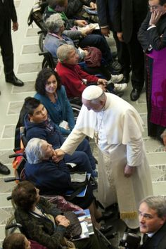 Pope Francis greets people during meeting with Catholic pilgrimage association at Vatican