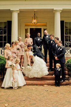 classic wedding party picture. Love the blush bridesmaids dresses!