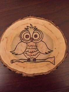 A set of four all natural dried rustic cherry tree wood burned coasters! They are approximately 3 to 3.5 inches in diameter and all have slightly different shapes. Coasters are trimmed with all natural bark around the edges and have a wood burned owl design. Perfect décor for the rustic home. They are all coated with polyurethane to protect the integrity of the wood. *Custom designs and quantity may be ordered upon request. *All coasters are hand wood burned, NOT laser engraved.